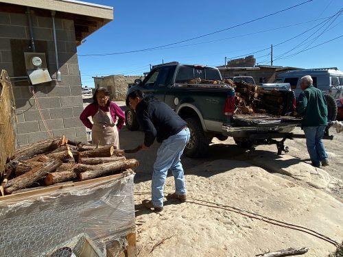 Unloading firewood at Hopi home illustrates Hopi winter heat project