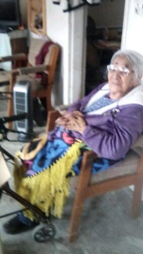 Hopi elder happy to receive a space heater.