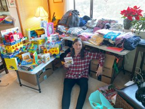 One of our volunteers organizing children's gifts she shopped for..